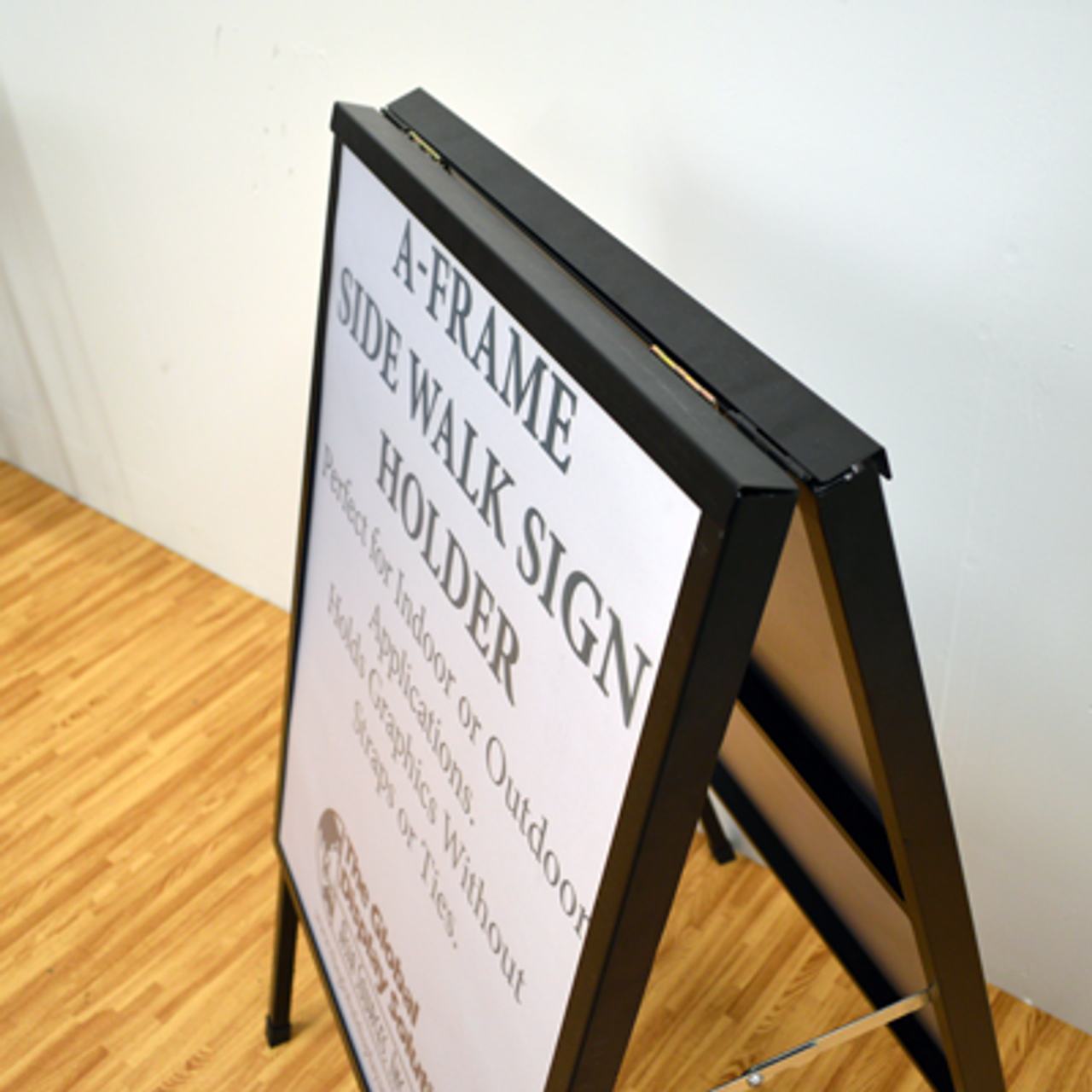 Hinged top keeps signs secure during use