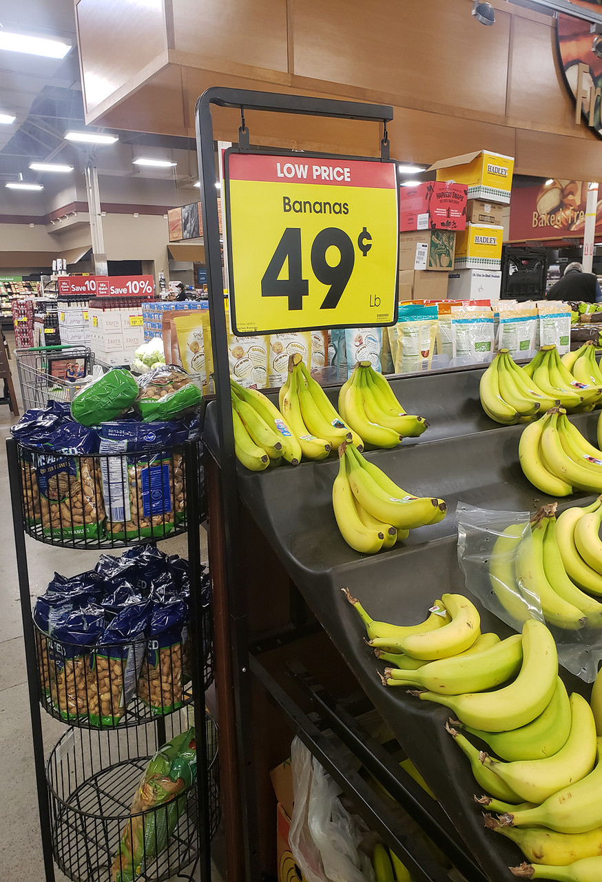 """Pallet sign holder - adjustable height- 14""""w x 11""""h metal frame included - example over a banana display"""