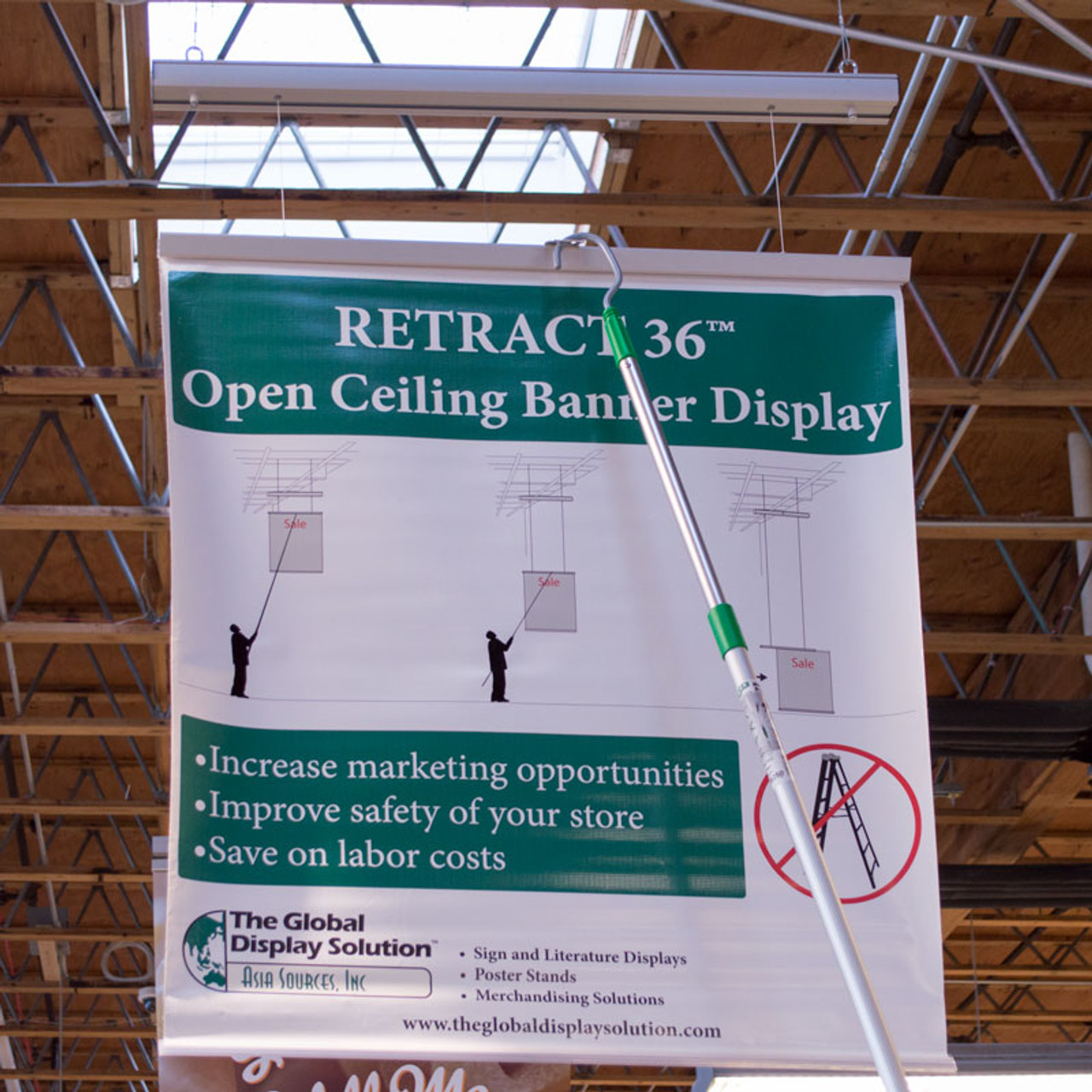 Eliminate dangerous ladders at your workplace by using the ladder-free banner system which retracts and lowers.