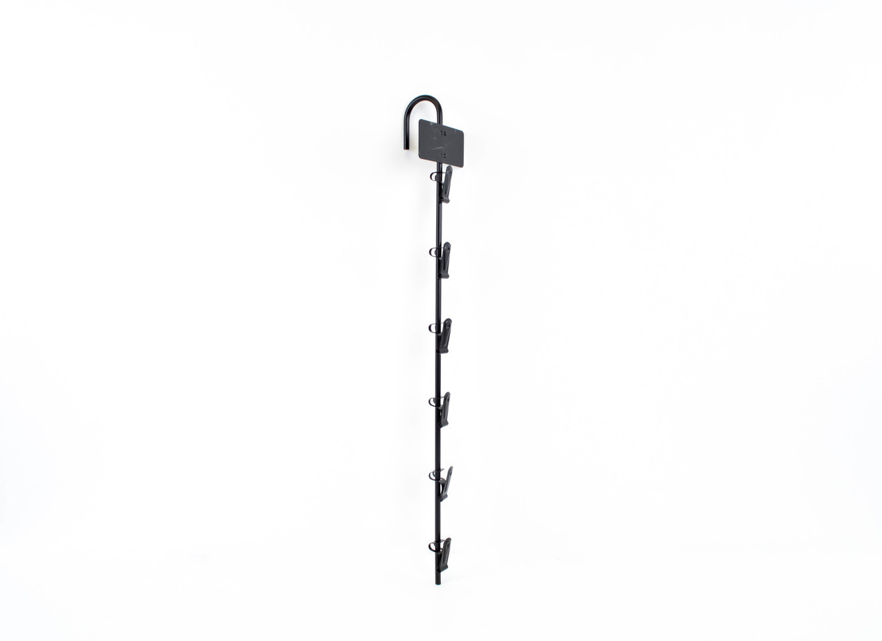 6 clip metal cane merchandiser with label holder attached.