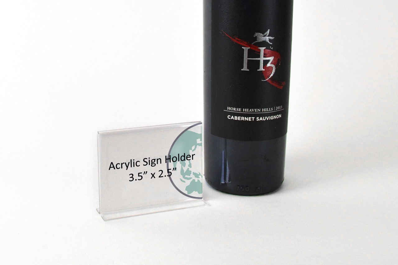 Small acrylic sign holder for merchandising in retail stores.