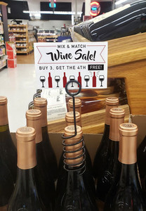 Bottle Talker for elegantly displaying promotional labels and signs.