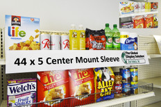 "Sign protector clips into standard 1.25 inch channels and displays large 44""w x 5""h signs on retail shelves."