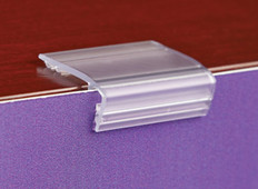 Flush sign gripper for displaying signs on tables and shelves.