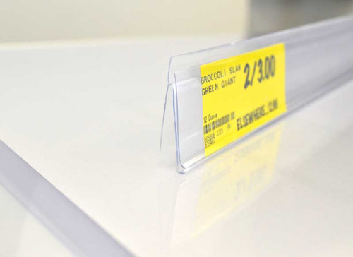 Clear shelf strips clip into standard shelf channels for displaying 1.25 inch labels.