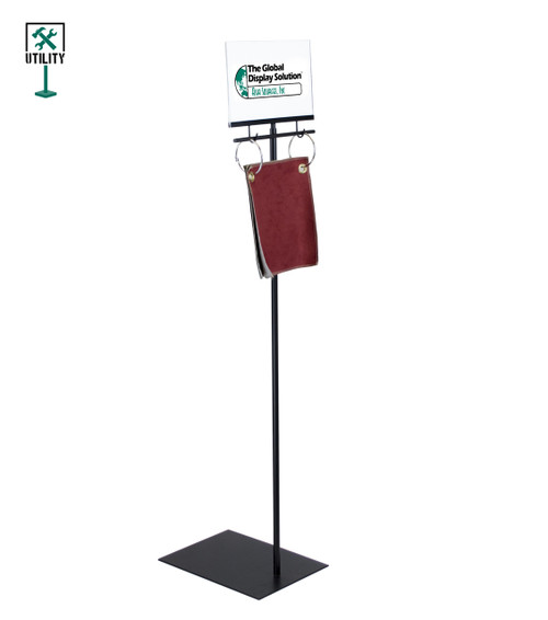 Acrylic sign holder with hanging hooks for fabric samples.