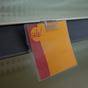 Display signs and labels on shelves with ticket holders -