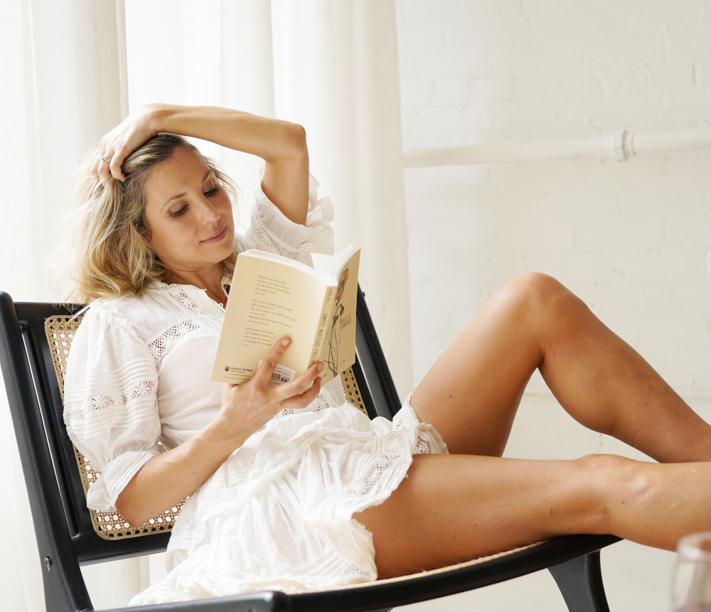 CBD_Helps_Woman_Relax_with_book