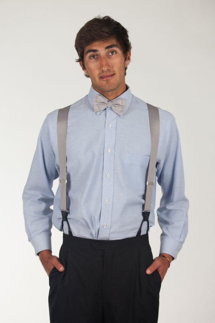 Model wearing bow tie & suspenders