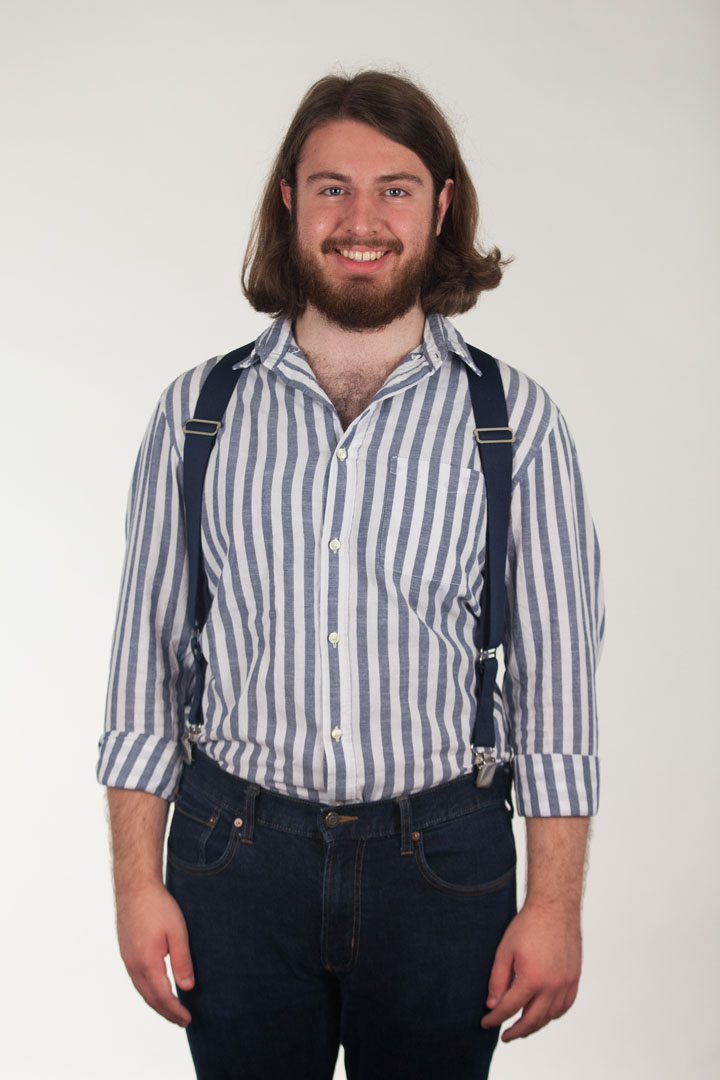 Model Wearing Navy Side Clip Suspenders, 1.5-Inch Wide - Construction Clip Front View