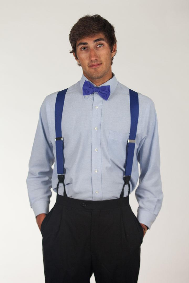 Model wearing bow tie & suspenders