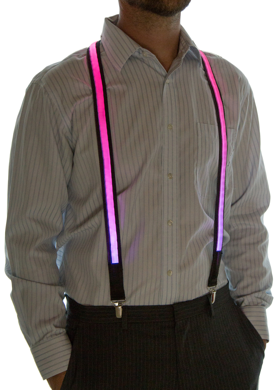 Model wearing suspenders set to Pink