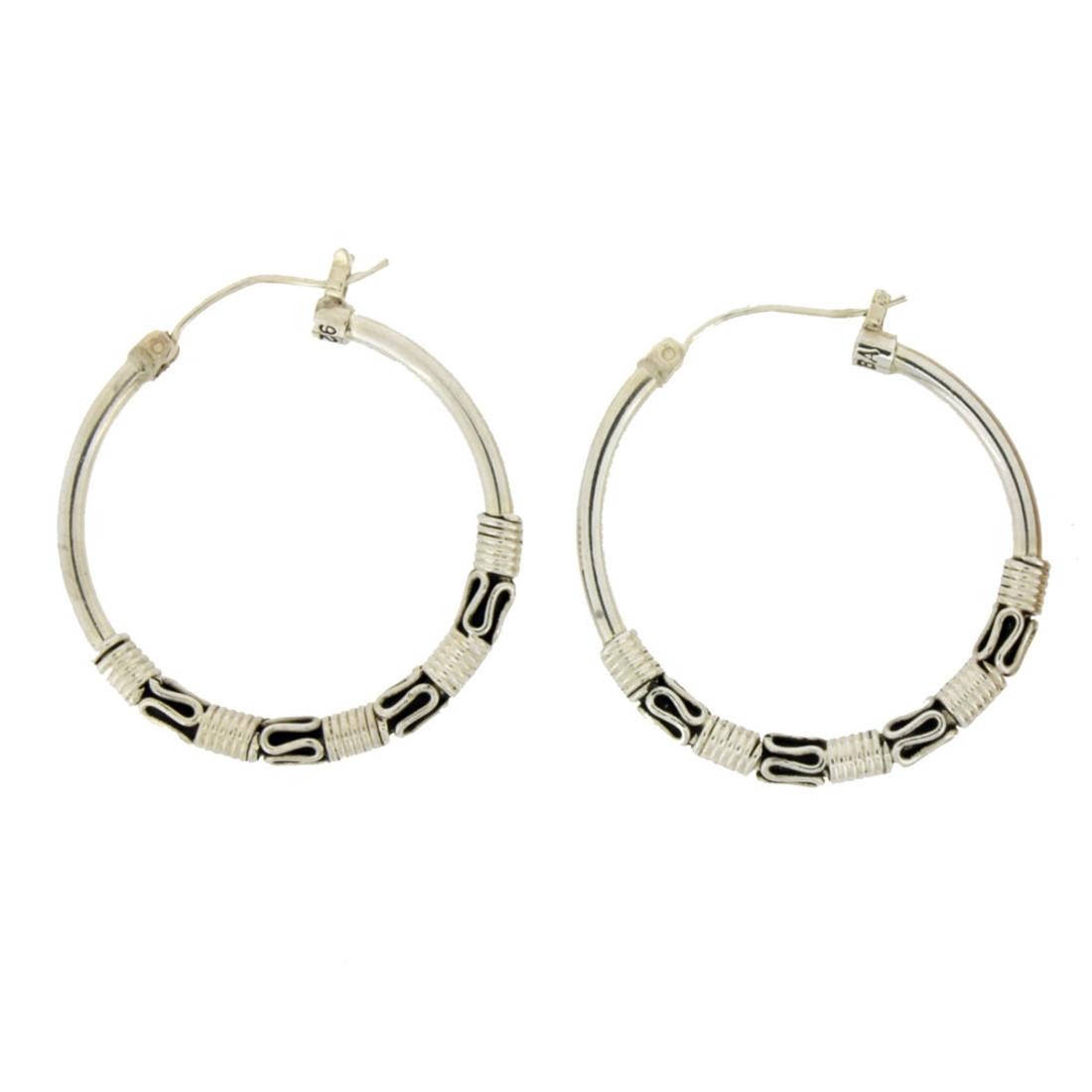 Sterling silver hoop earrings with Bali detail.