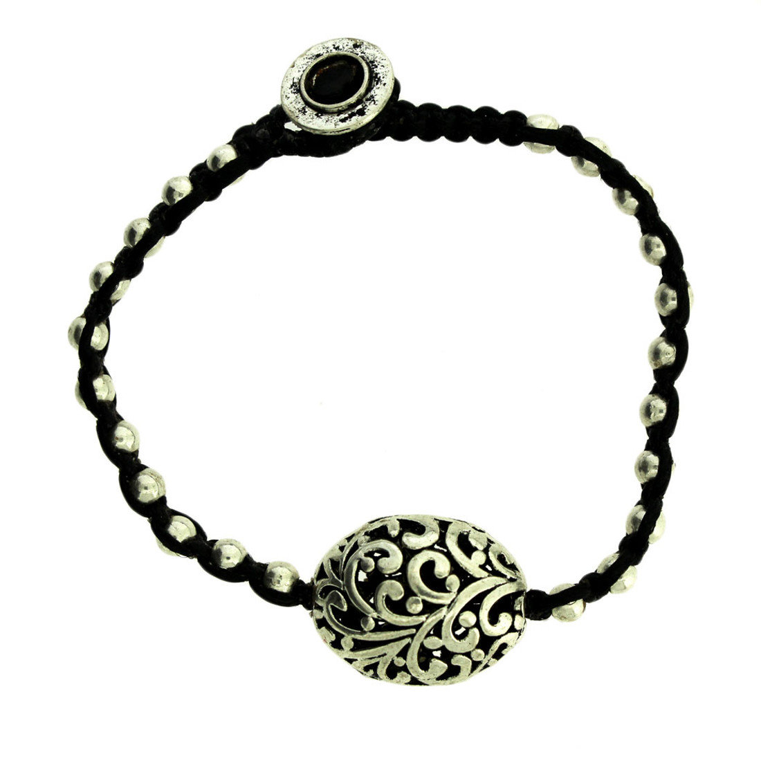 One large floral design alloy bead with smaller alloy beads on bracelet.
