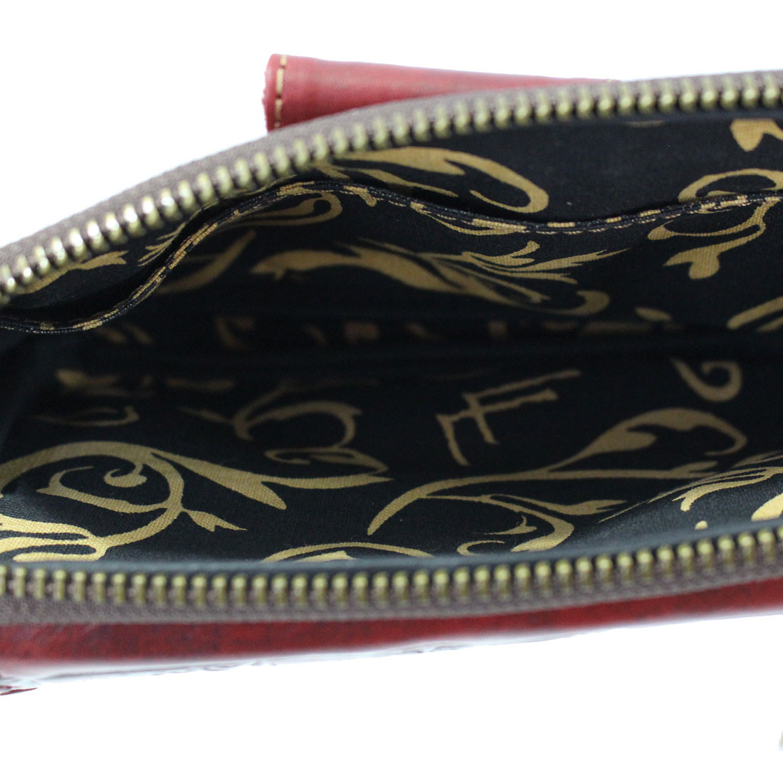 Inside fabric of red leather wallet.