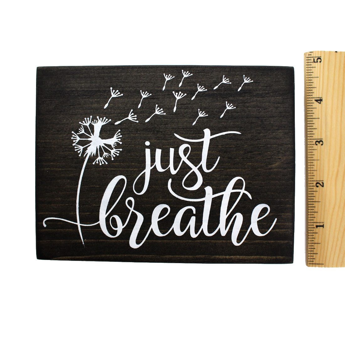 Frontside and ruler of Just Breathe wooden sign.