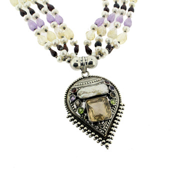 Multi stone beaded necklace with large sterling silver pendant.