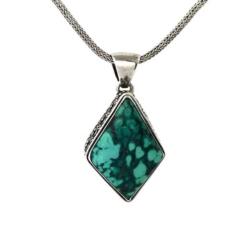 Large Turquoise sterling silver pendant on a chain.