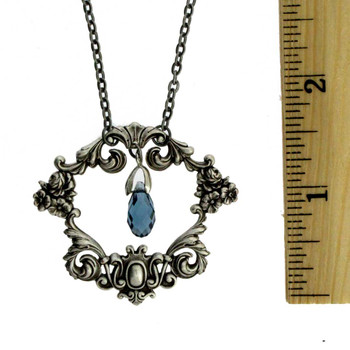 Silver plated floral frame necklace with ruler.