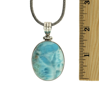 View with ruler to tell the size of the ocean blue Larimar sterling silver pendant.