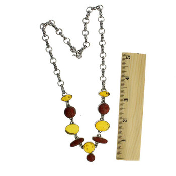 Amber and coral sterling silver necklace with a ruler.