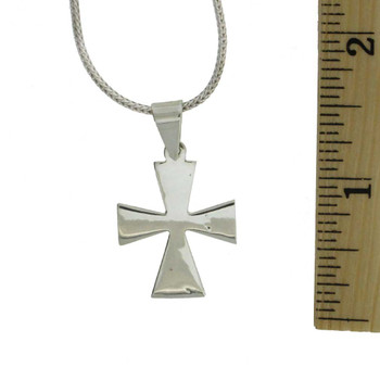 Sterling silver cross pendant with a ruler.