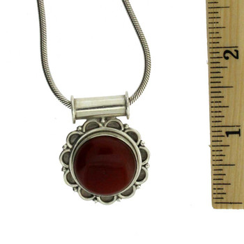 Sterling Silver Reddish Brown Carnelian Pendant with ruler.