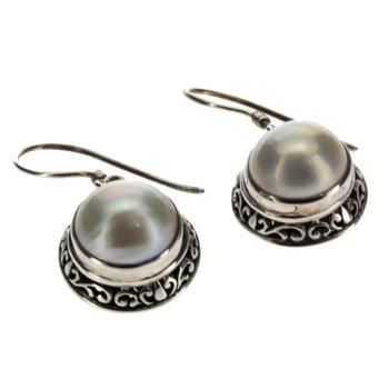Bali design Pearl sterling silver dangle earrings side view.