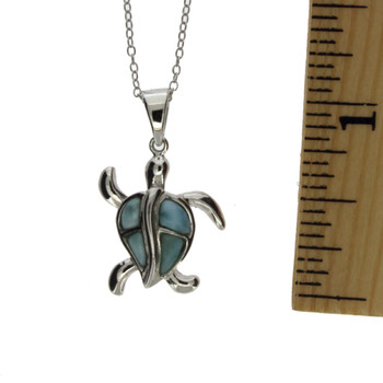 Sterling silver sea turtle with Larimar stones.