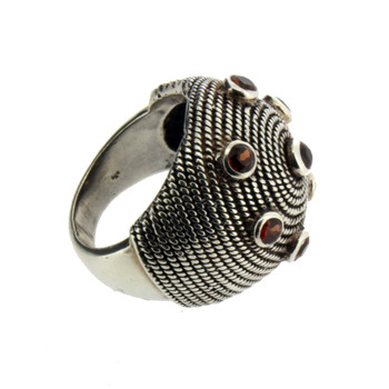 Side view or large Garnet silver ring.