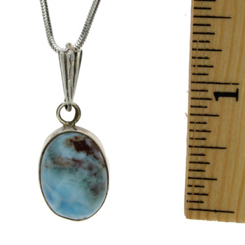 Small oval Larimar pendant with ruler.