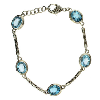 Sterling silver blue Topaz bracelet with Byzantine chain.