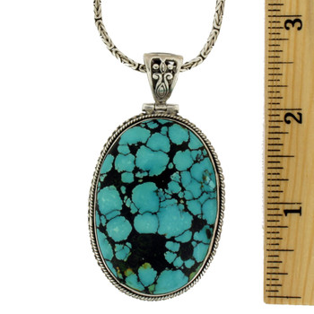 Large Turquoise pendant with ruler.