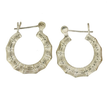 Textured sterling silver hoops.
