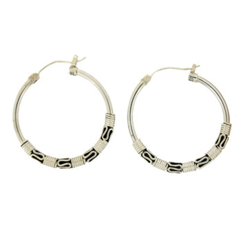 Sterling silver hoop earrings with Bali detail.