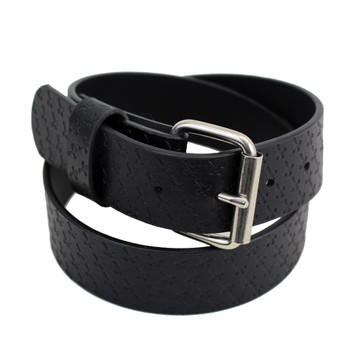 Embossed cross black leather belt.