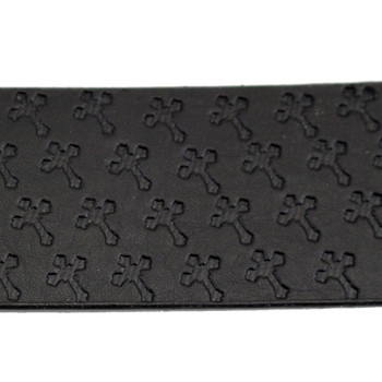 Close up picture of embossed cross black leather belt.