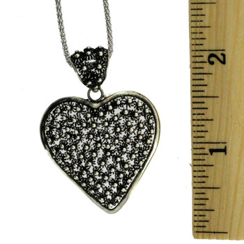 Heart sterling silver pendant with ruler.