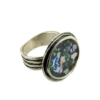 Roman glass sterling silver ring on its side view.