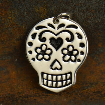 Day of the dead pendant charm shown with background.