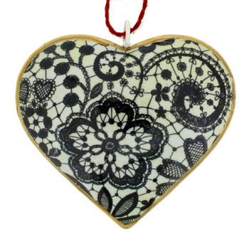 Backside of Day of the Dead pansy flower metal heart ornament.