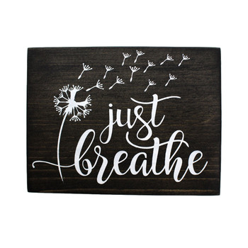 Frontside of Just Breathe wooden sign.