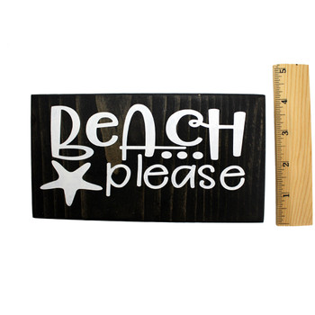 Front side with ruler of small wooden sign Beach Please.