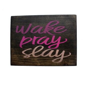 Front side of Wake Pray Slay small wooden sign.