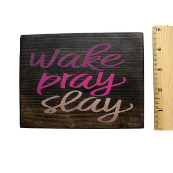 Front side with ruler of Wake Pray Slay small wooden sign.