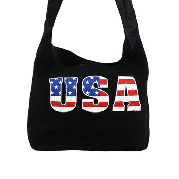 Close up picture of black sling bag with USA American Flag on front.