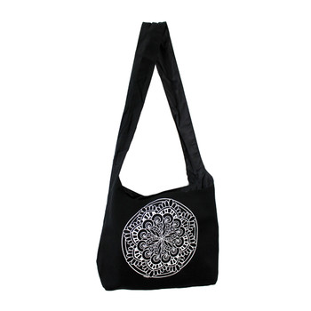 Black canvas sling bag with white Mandala on front of bag.