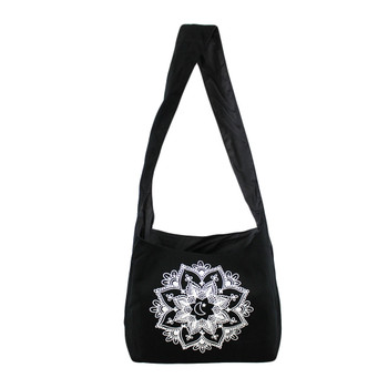 Black canvas sling bag with white Mandala on front of bag.