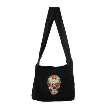 Black sling bag with colorful Day of the Dead skull on front of bag.