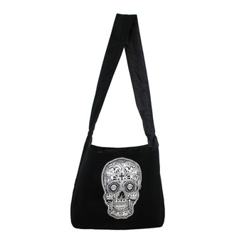 Black and white Day of the Dead skull on black canvas sling bag.